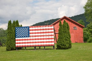 Roadside American flag sign with knobs, Wingdale, New York